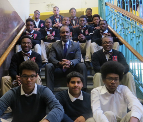 These are 15 past and current Urban Ambassador students from Brooklyn School for Math and Research, where Principal Perry Rainey, center, actively encourages students to join the program. (Courtesy of Perry Rainey)