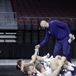 BYU basketball coach Mark Pope fist bumps players prior to a WCC semifinal game against Pepperdine at the Orleans Arena in Las Vegas on March 8, 2021.