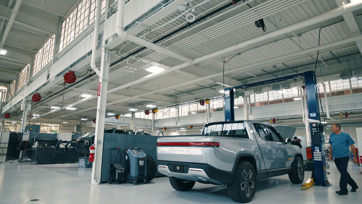 An industrial space with a built car.