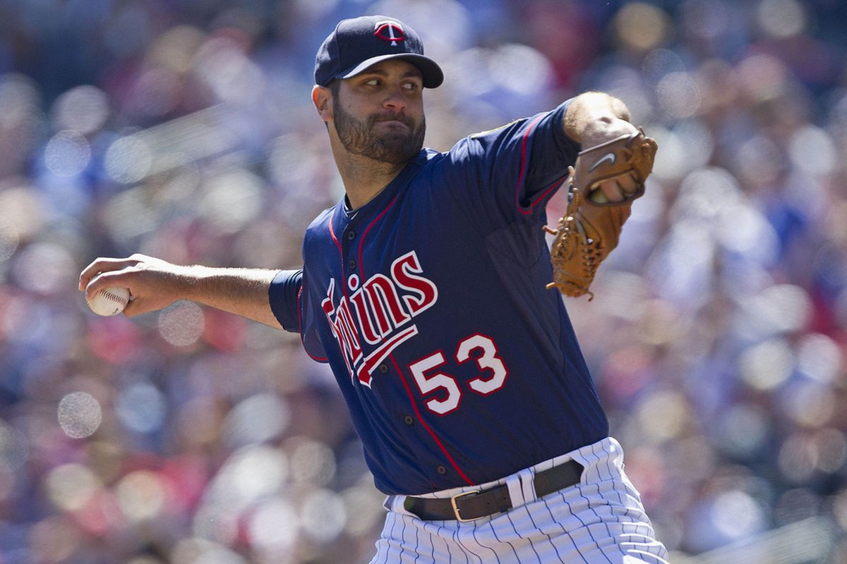Apr 14, 2012; Minneapolis, MN, USA: Minnesota Twins starting pitcher Nick Blackburn (53) pitches in the first inning against the Texas Rangers at Target Field. Mandatory Credit: Jesse Johnson-US PRESSWIRE