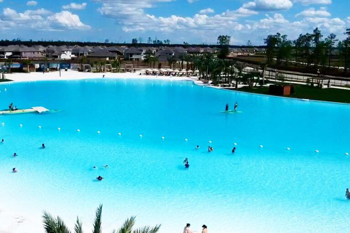 A manmade lagoon with turquoise water and white sands.