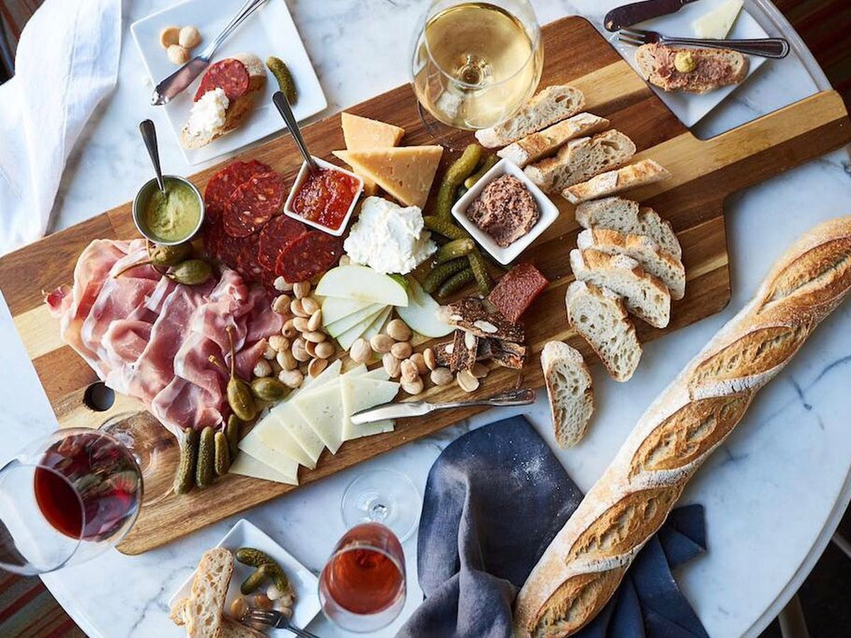 a very large cheese board, viewed from overhead