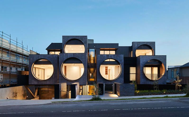 Modern apartment building overlooks street with six \'eyes\' - Curbed