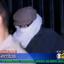 In this image from video provided by CBS2-KCAL9, Nakoula Basseley Nakoula, the man behind the anti-Muslim movie that has inflamed the Middle East, is escorted by Los Angeles County sheriff's deputies from his home, early Saturday, Sept. 15, 2012, in Cerritos, Calif.  Nakoula, 55, was interviewed by federal probation officers at a Los Angeles sheriff's station but was not arrested or detained, authorities said early Saturday.