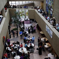 Around the atrium at top, couples wait to get marriage licenses outside the Salt Lake County clerk's office, Monday, Dec. 23, 2013. At center, couples are married. U.S. District Judge Robert Shelby denied a motion by the state of Utah to halt same-sex marriages pending an appeal.