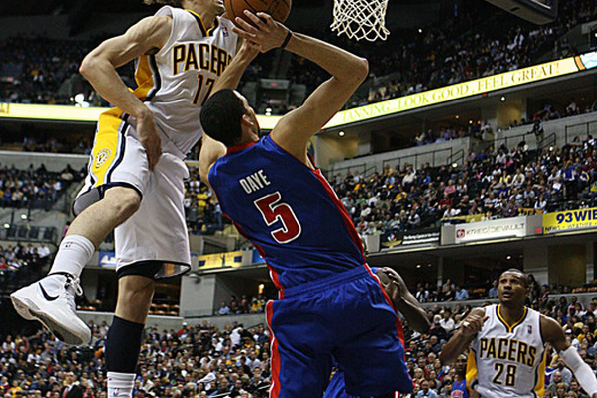 Apr 23, 2012; Indianapolis, IN, USA; Detroit Pistons forward Austin Daye (5) is fouled by Indiana Pacers forward Lou Amundson (17) at Bankers Life Fieldhouse.  Mandatory Credit: Brian Spurlock-US PRESSWIRE