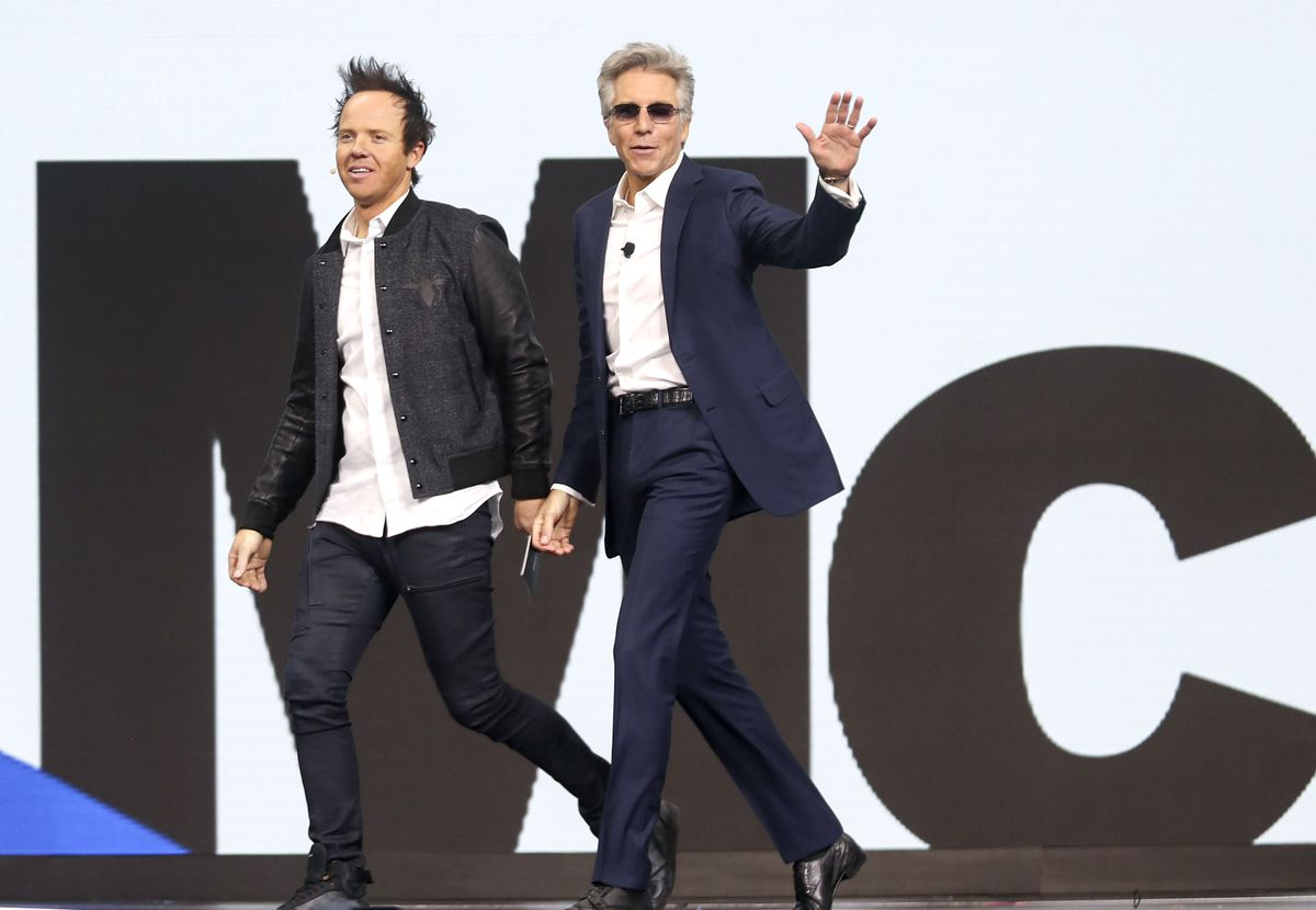 Bill McDermott, CEO of software company SAP, right, reacts to the applause as he is introduced by Qualtrics co-founder and CEO Ryan Smith, left, during the Qualtrics X4 Summit at the Salt Palace Convention Center in Salt Lake City on Thursday, March 7, 2019.