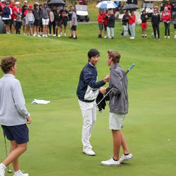 Woods Cross' Rex Poulsen, Skyline's Peter Kim and Spanish Fork's Jackson Rhees congratulate each other at the end of their second round in the 5A boys state golf tournament at The Oaks at Spanish Fork in Spanish Fork on Tuesday, Oct. 5, 2021. Kim and his teammates at Skyline took the team title while Rhees took the individual title.