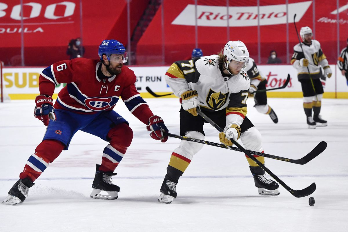Vegas Golden Knights forward William Karlsson (71) plays the puck and Montreal Canadiens defenseman Shea Weber (6) defends during the third period in game four of the 2021 Stanley Cup Semifinals at the Bell Centre.