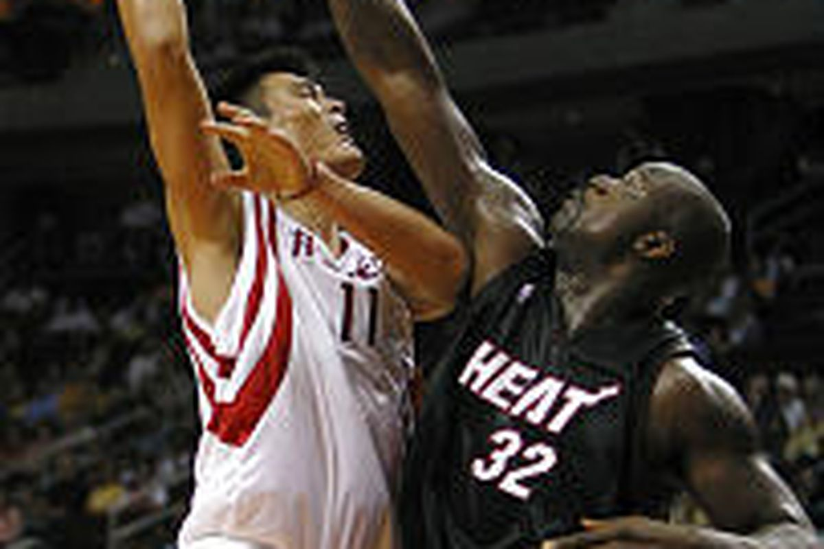 Miami's Shaquille O'Neal (32) fouls Houston's Yao Ming in NBA preseason action Sunday.