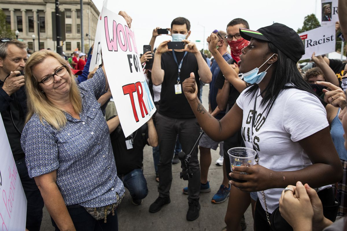 Supporters of President Donald Trump and Black Lives Matter protesters argue and shout over each other outside of the Kenosha County Courthouse, in anticipation of the president's arrive in the Wisconsin city, Tuesday afternoon.