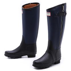 """For serious stomping in the mud, it doesn't get chicer than these Hunter + Rag & Bone rain boots. $295 at <a href=""""http://www.intermixonline.com/product/rag+%26+bone+for+hunter+tall+rain+boots-+navy-black.do?sortby=ourPicks&from=Search"""">Intermix</a>, 2409"""