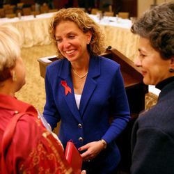 From left, Aleita Huguenin, Democratic National Committee Chairwoman Debbie Wasserman Schultz, and Patrice Arent chat at the DNC's Executive Committee meeting at the Montage Deer Valley in Park City on Saturday, Dec. 1, 2012.
