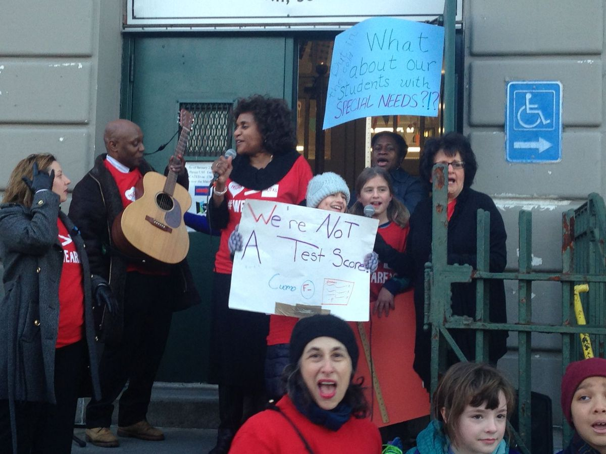 P.S. 10 Principal Laura Scott leads students and parents in song to protest Cuomo's policies.