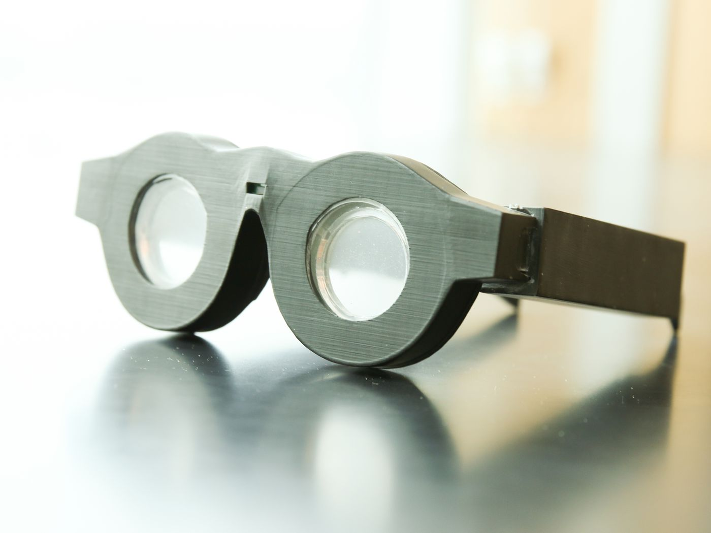 eea882230c1 These smart glasses automatically focus on what you re looking at - The  Verge