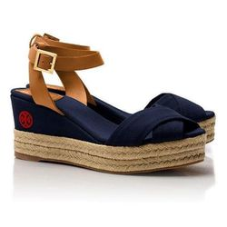 """Karissa Espadrille Wedge, $136.50 (on sale from $195) at <a href=""""http://www.toryburch.com/Karissa-Espadrille-Wedge/12138405,default,pd.html?dwvar_12138405_color=409&start=5&q=espadrille"""">Tory Burch</a>"""