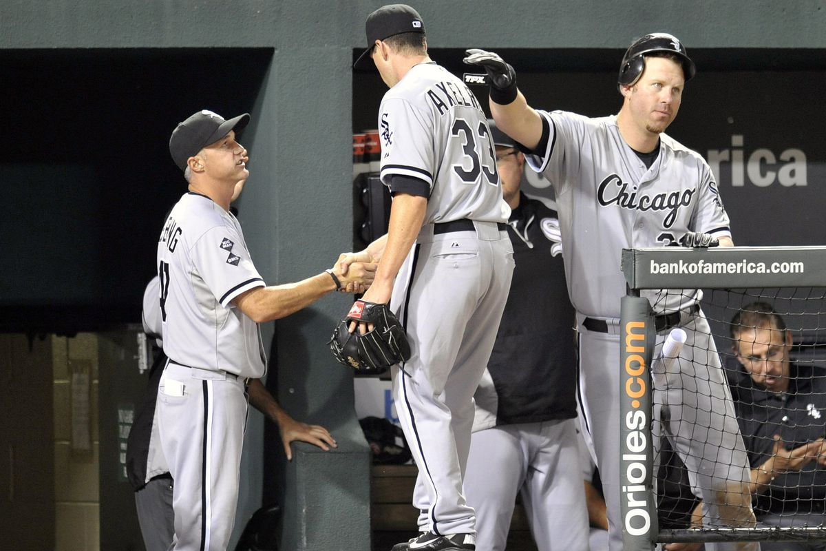 While Joe McEwing provides the distraction, Adam Dunn shoves Dylan Axelrod down the trap door to Birmingham.
