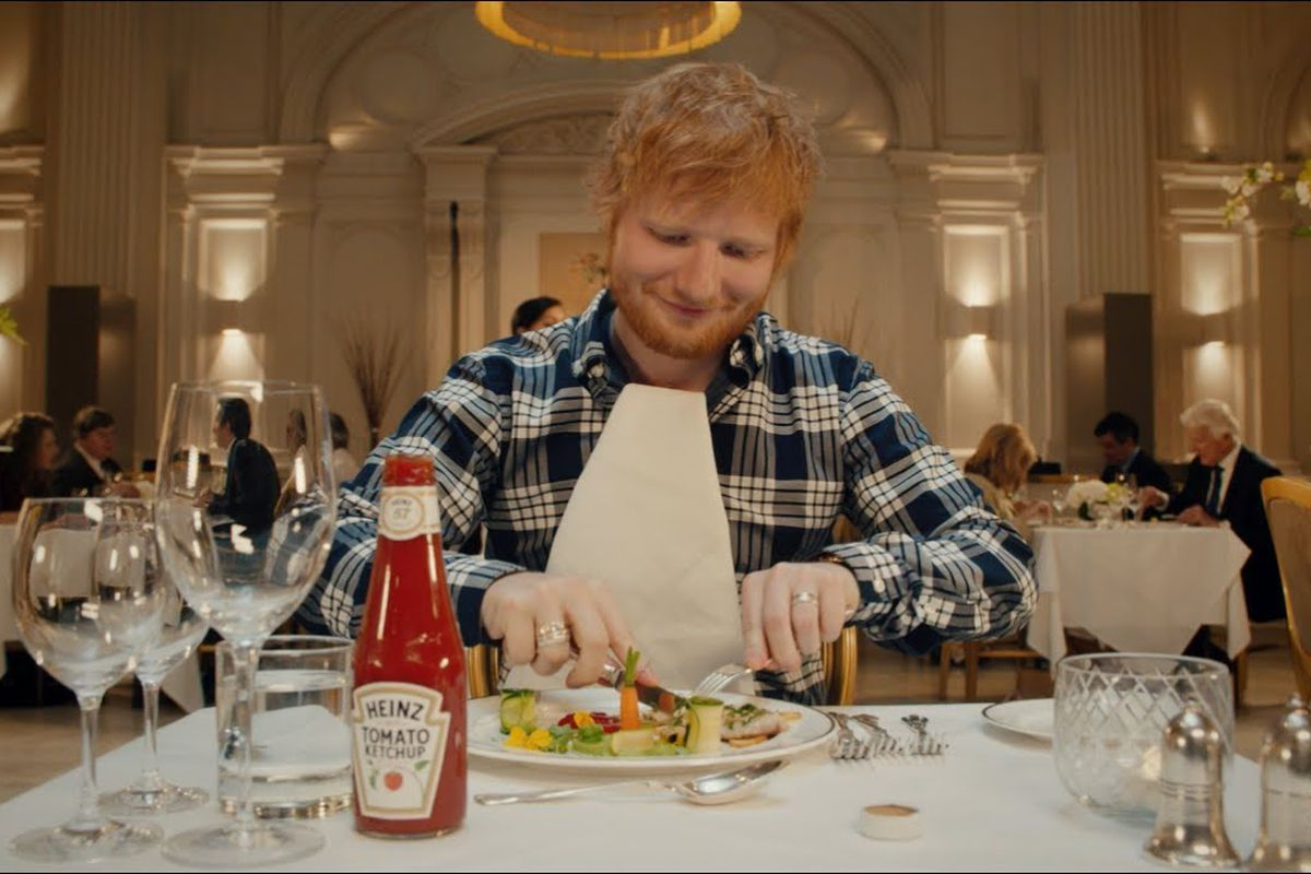 Ed Sheeran's Heinz Tomato Ketchup advert sees The Shape of You pop star covering his food in ketchup at a Michelin star cliché restaurant