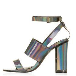 """<b>Topshop</b>, <a href=""""http://us.topshop.com/en/tsus/product/shoes-70484/heels-70512/relish-metallic-sandals-3610829?bi=1&ps=200"""">$90</a>"""