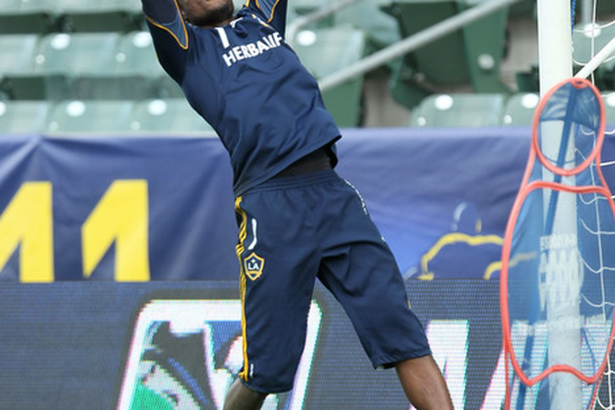 CARSON, CA - NOVEMBER 19: Goalkeeper Donovan Ricketts #1 of the LA Galaxy jumps for a ball during a training session ahead of the MLS Cup at The Home Depot Center on November 19, 2011 in Carson, California.  (Photo by Stephen Dunn/Getty Images)