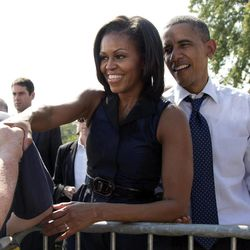 President Barack Obama and first lady Michelle Obama shake hands at a campaign event at Strawbery Banke Museum in Portsmouth, N.H., Friday, Sept. 7, 2012.