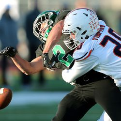 Timpview's Clayton Koford tackles Provo's Ryan Harward as the two teams play in quarterfinal football action in Provo on Friday, Nov. 8, 2019. Timpview won 26-7.