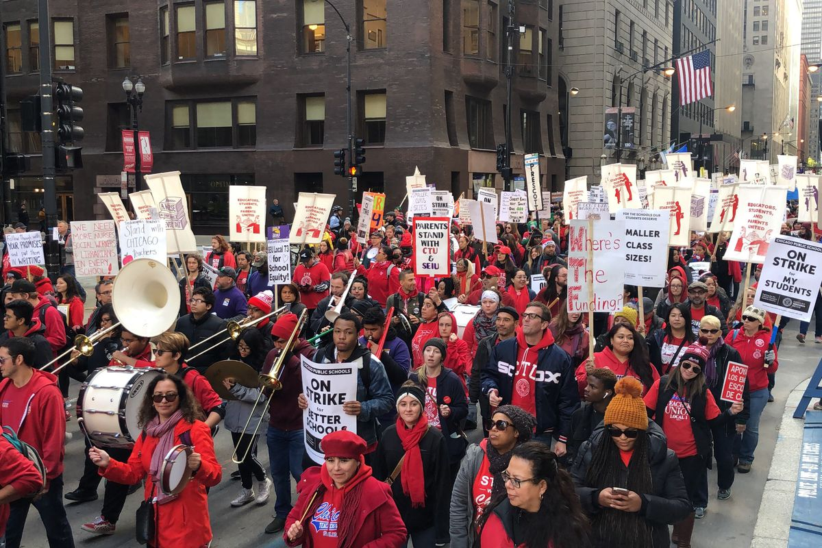 Striking Chicago teachers and supporters march downtown in a rally midday Oct. 17, 2019, to press their demands.