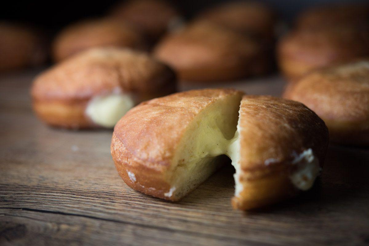 A close-up of a cream-filled doughnut split in half at Ba Bar.
