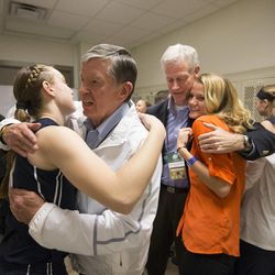 Then-BYU President Cecil Samuelson and then-vice president Kevin Worthen console members of the university's women's basketball program after BYU lost to No. 1 and undefeated Connecticut in the NCAA tournament on March 29, 2014. Worthen replaced Samuelson as president on Thursday, May 1, 2014.