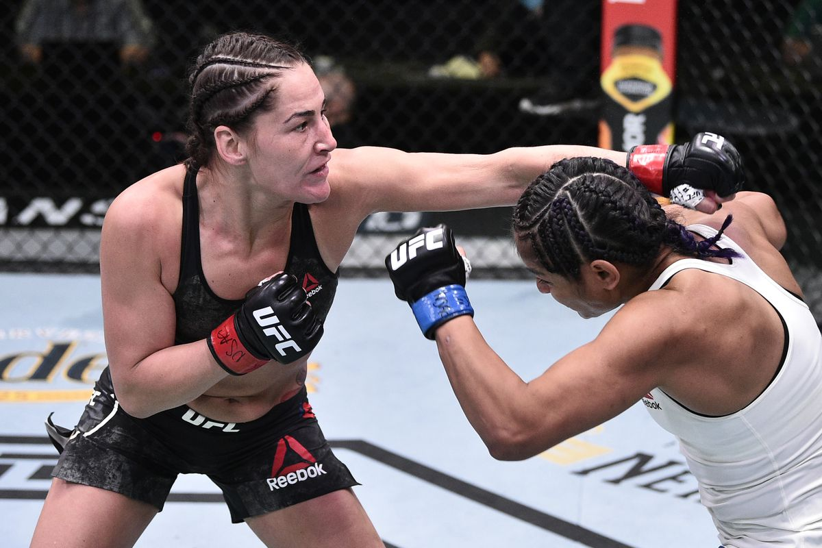Jessica Eye punches Cynthia Calvillo in their flyweight fight during the UFC Fight Night event at UFC APEX on June 13, 2020 in Las Vegas, Nevada.