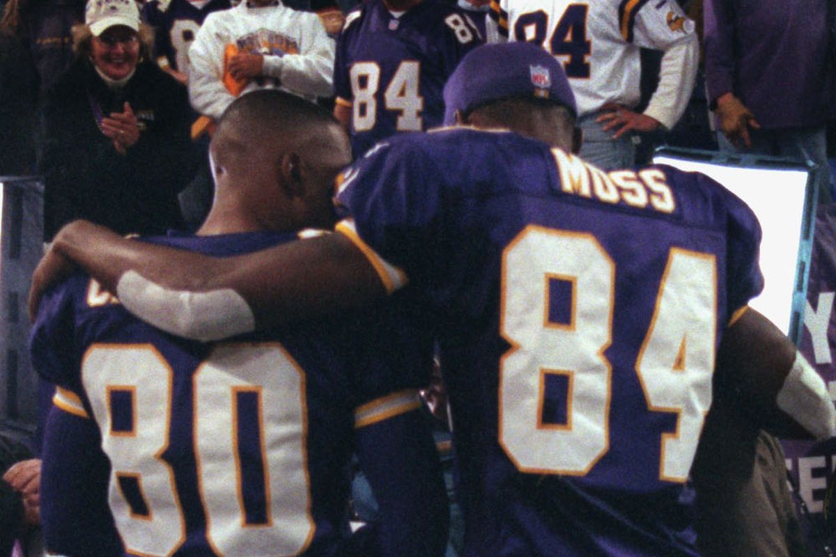GENERAL INFORMATION: Vikings home vs. Tampa Bay Buccaneers. 8:00 pm start IN THIS PHOTO: Viking wide receivers Cris Carter, left, and Randy Moss , right, do a television interview following the Vikings Monday night victory over Tampa Bay at the Metrodome