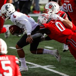 Washington State Cougars quarterback Jayden de Laura (4) is brought down by the Utah Utes defense during an NCAA football game at Rice-Eccles Stadium in Salt Lake City on Saturday, Dec. 19, 2020.