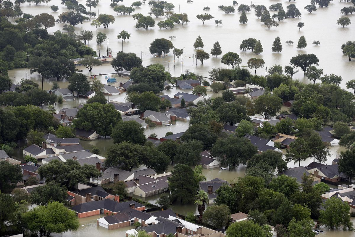 Homes are flooded near the Addicks Reservoir as floodwaters from Tropical Storm Harvey rise Tuesday in Houston. | David J. Phillip/Associated Press