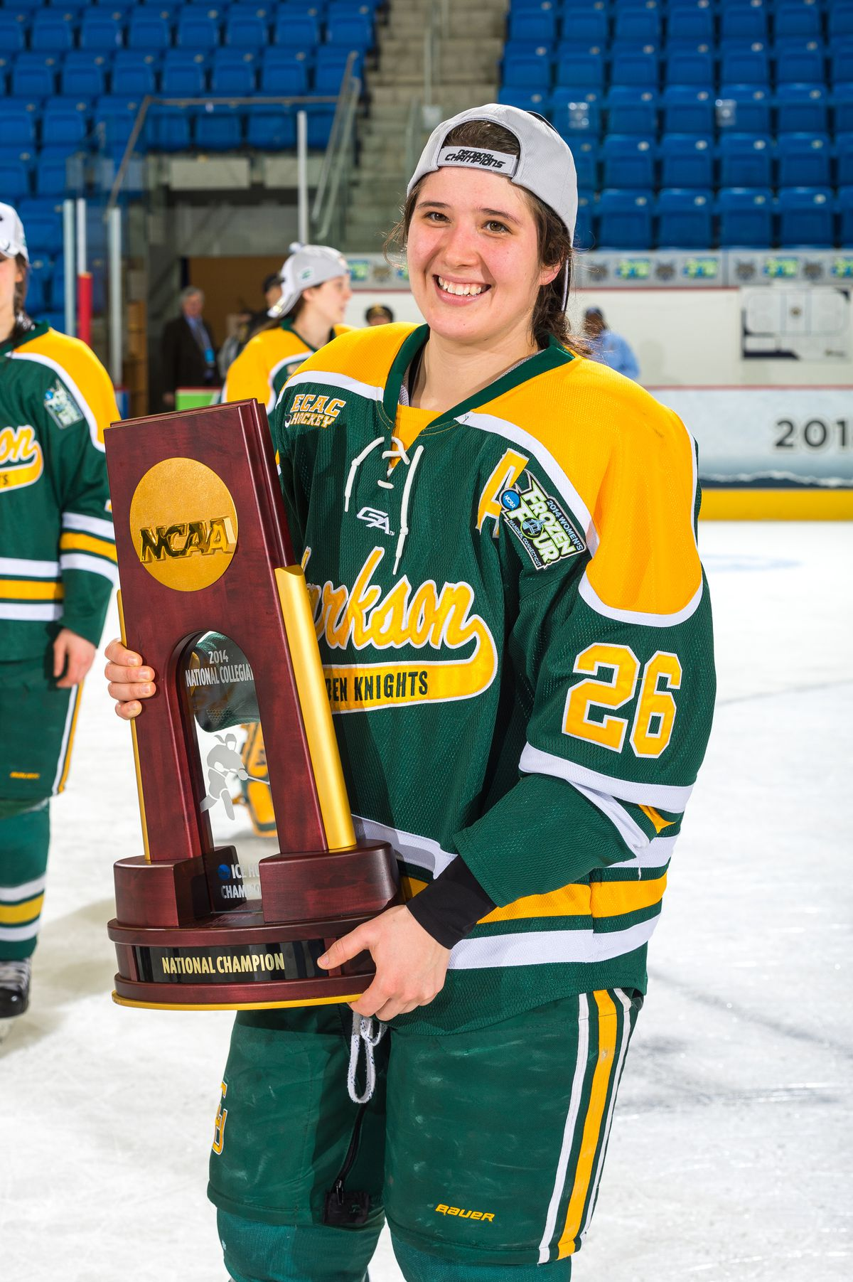 Jamie Lee Rattray poses for a photo with the national championship trophy after the 2014 NCAA title game.