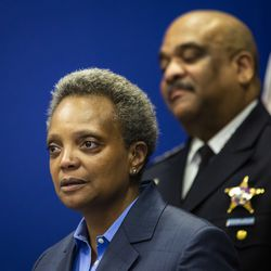 Chicago Police Department Supt. Eddie Johnson looks on as Mayor Lori Lightfoot gets emotional speaking about his retirement during a press conference at CPD headquarters, Thursday morning, Nov. 7, 2019.