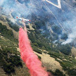 A tanker drops retardant on a wildfire at the mouth of Weber Canyon on Tuesday, Sept. 5, 2017.