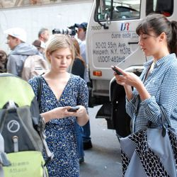 Stefanie Skinner and Emily Bungert of People's Revolution do what they do best outside the event.