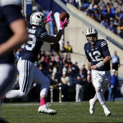 Brigham Young Cougars quarterback Tanner Mangum passes to Brigham Young Cougars tight end Matt Bushman during NCAA football against the San Jose State Spartans in Provo on Saturday, Oct. 28, 2017.