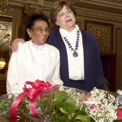 File - Velma Saunders, 91, receives outstanding older worker award from Green Thumb presented by Olene S. Walker at the Capitol Thursday, May 17, 2001.