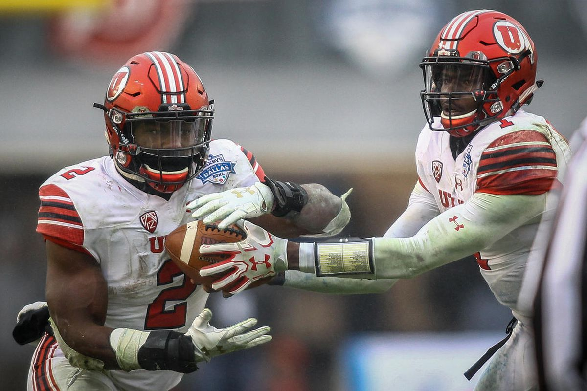 Utah quarterback Tyler Huntley hands the ball off to running back Zack Moss during the Zaxby's Heart of Dallas Bowl in Dallas Texas on Tuesday, Dec. 26, 2017.