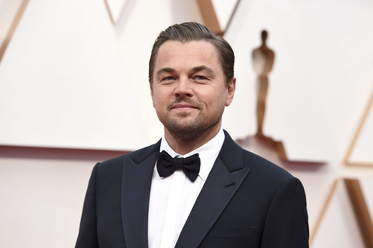 Leonardo DiCaprio arrives at the Oscars in Los Angeles in February. DiCaprio is helping to launch the $12 million America's Food Fund aimed at helping low-income families, the elderly and those whose jobs have been disrupted by the coronavirus pandemic.