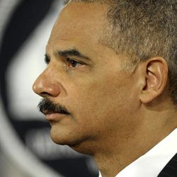 Attorney General Eric Holder listens during a news conference at the Justice Department in Washington, Wednesday, April 11, 2012. The Justice Department and several states have sued Apple Inc. and major book publishers, alleging a conspiracy to raise the price of electronic books that Attorney General Eric Holder says cost consumers millions of dollars.