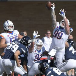 Boise State defensive tackle Scott Matlock (99) blocks the field goal attempt of Utah State place kicker Connor Coles (59) during the first half of an NCAA college football game Saturday, Sept. 25, 2021, in Logan, Utah.