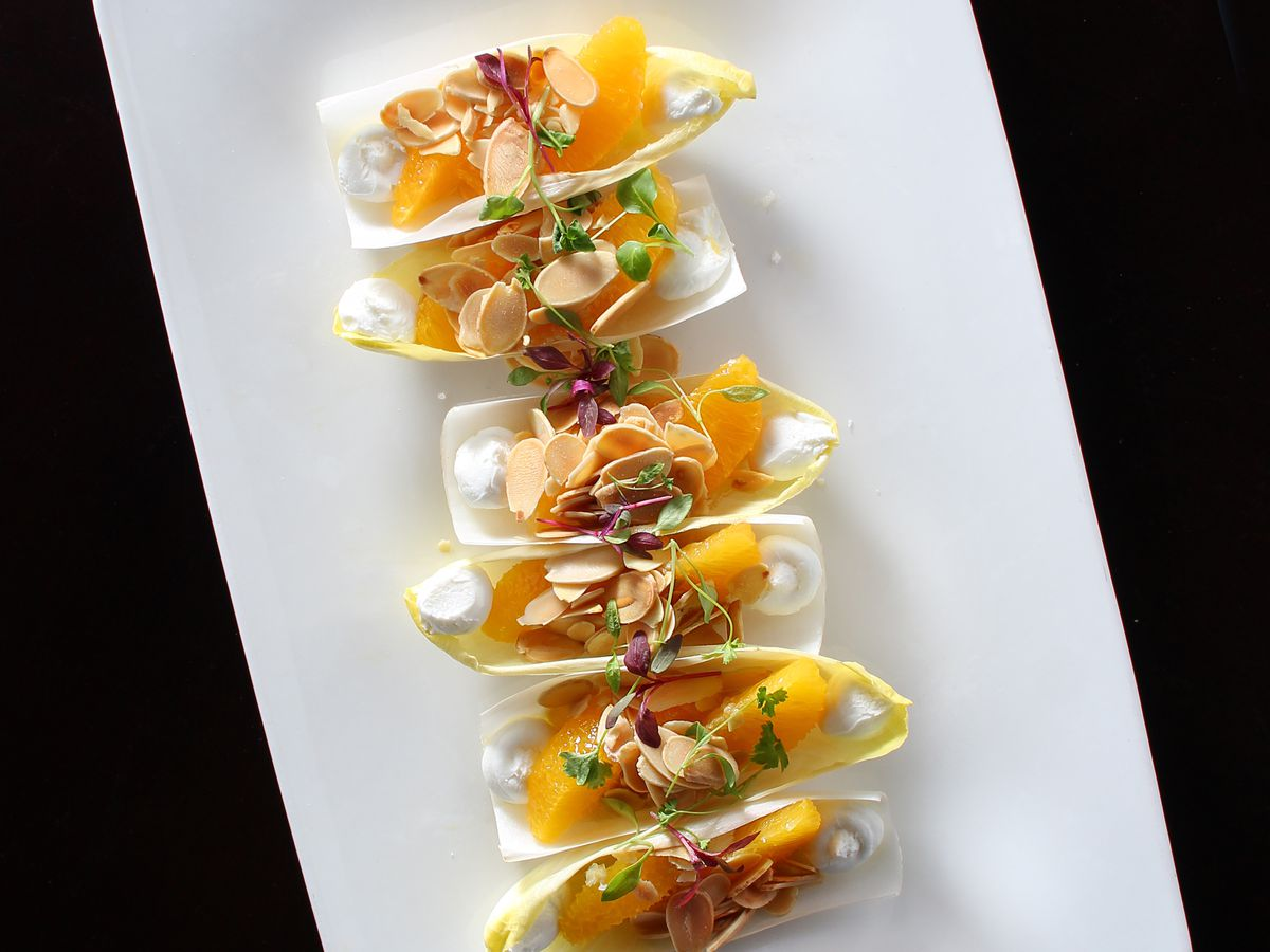 Endive leaves filled with goat cheese, oranges, almonds, and smoked salmon roe at Jaleo
