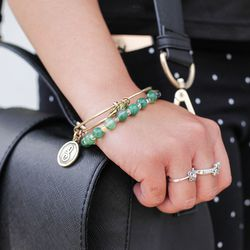 Her rings are from street fairs, her bag is H&M, the green bracelet was a gift from her grandfather, and her other bracelet is Alex and Ani.