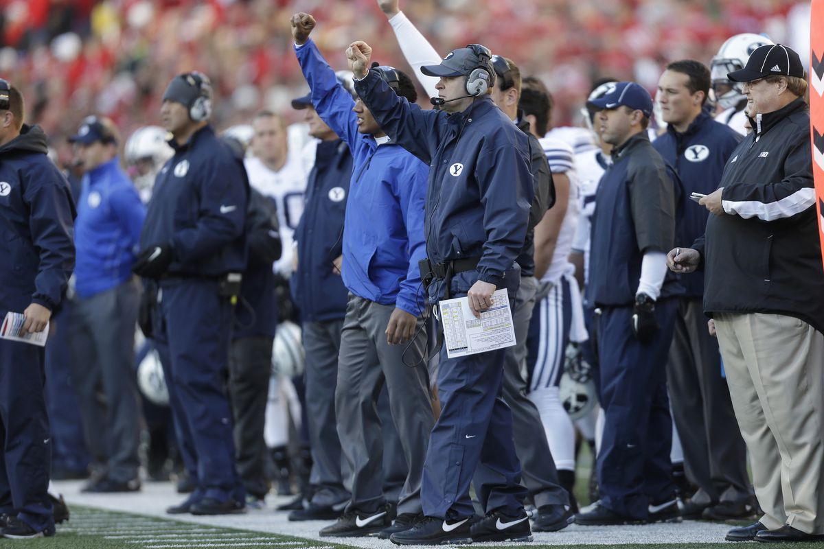 Coaches call plays on the sideline.