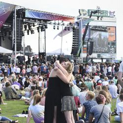 Dee Gordon, of Heber City, and Heather Marie, of Bluffdale, embrace at the beginning of the LoveLoud Festival at Utah Valley University in Orem on Saturday, Aug. 26, 2017.  The two, who have known each other for three years, said that they were at the LoveLoud Festival to support their family and friends.
