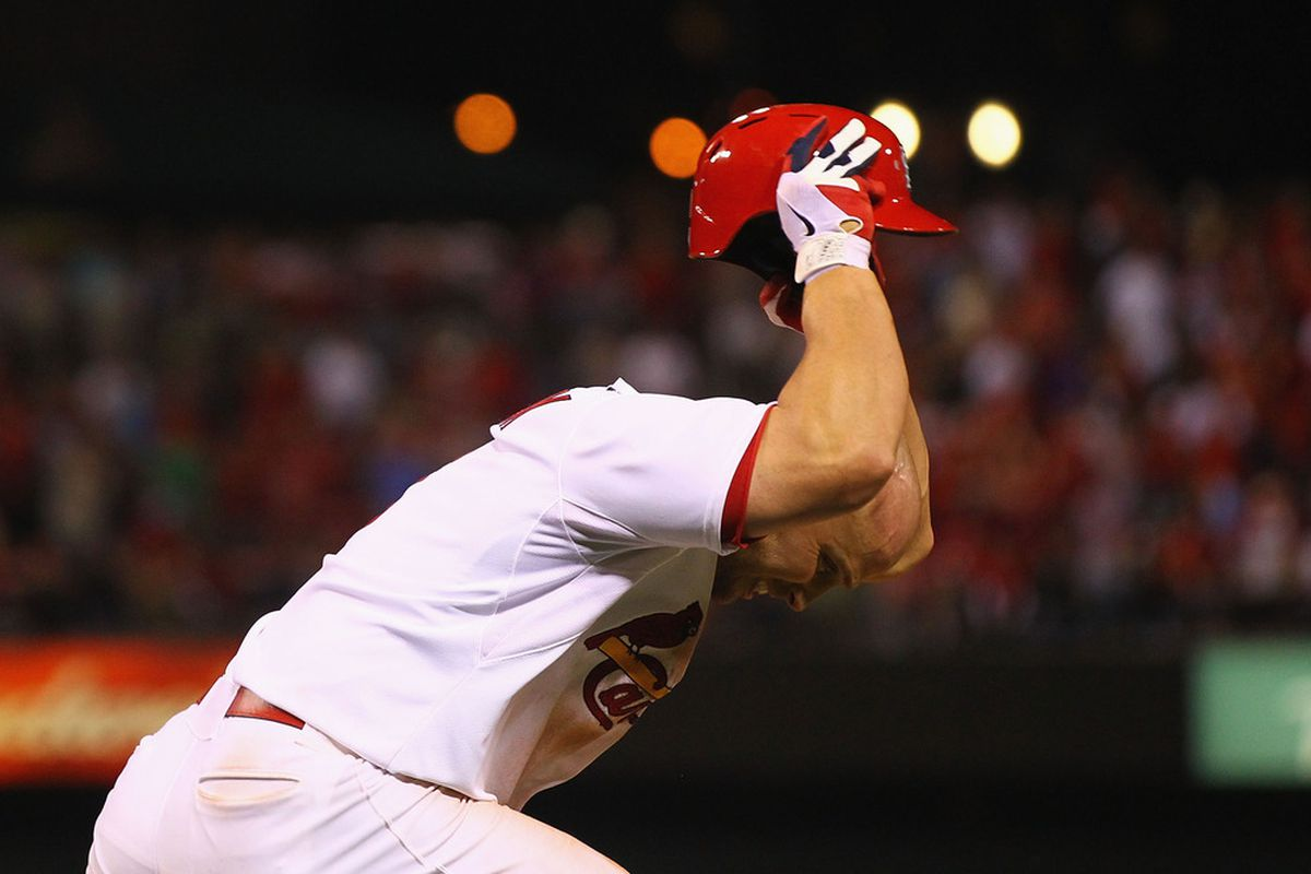 ST. LOUIS, MO - MAY 11: Matt Holliday #7 of the St. Louis Cardinals slams his helmet to the ground after flying out against the Atlanta Braves at Busch Stadium on May 11, 2012 in St. Louis, Missouri.  (Photo by Dilip Vishwanat/Getty Images)