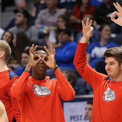 Gonzaga Bulldogs' bench celebrates a three point shot as BYU and Gonzaga play in an NCAA basketball game in the Marriott Center in Provo on Saturday, Feb. 24, 2018. Gonzaga won 79-65.