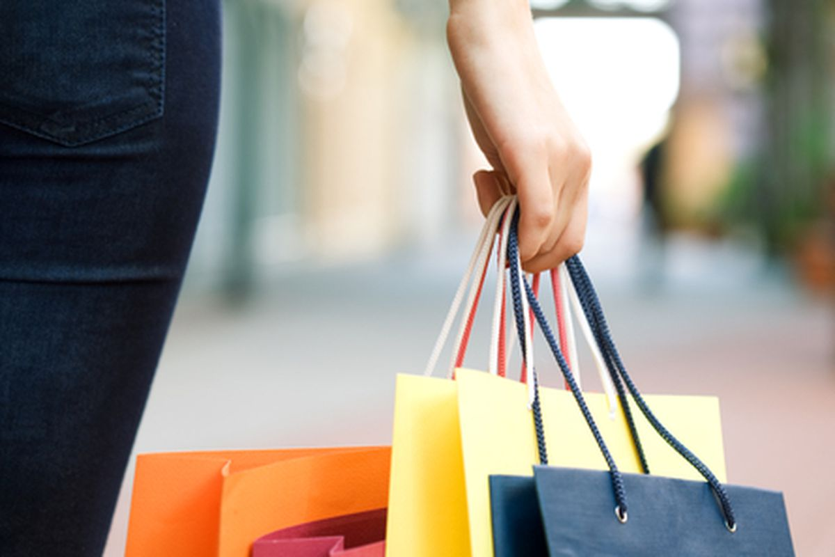 """Image via <a href=""""http://www.shutterstock.com/pic-39120208/stock-photo-hand-of-young-woman-with-multi-coloured-bags-with-purchases.html?src=csl_recent_image-1"""">Anatoly Tiplyashin</a>/Shutterstock"""